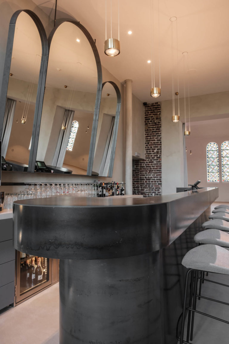 The shape of the bar is reminiscent of the chapel window shapes